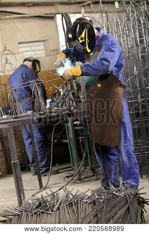 Welders at work.