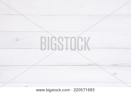 White wood texture background surface with old natural pattern or old wood texture table top view. Grunge surface with wood texture background. Vintage timber texture background. Rustic table top view.