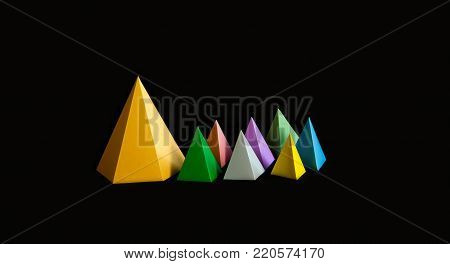 Multicolor minimalistic geometric abstract background. Bright prism pyramid triangle shape figures on black. Violet blue pink green gray yellow color solid objects. copy space.