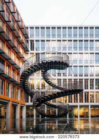 Munich, Germany - December 8, 2017: Endless Stairway Rewriting in KPMG Building in Munich designed by Olafur Eliasson