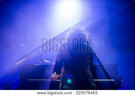 Pianist is playing piano live in concert.