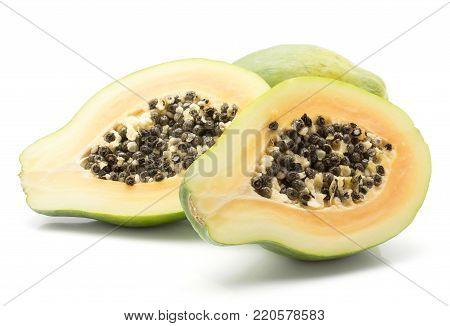Papaya (pawpaw, papaw) isolated on white background one whole and two sliced halves with orange flesh and seeds