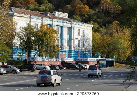 PETROPAVLOVSK-KAMCHATSKY CITY, KAMCHATKA PENINSULA, RUSSIAN FAR EAST - OCT 3, 2017: Autumn cityscape, view of building of Petropavlovsk-Kamchatsky Naval Officers House (Fleet House), Shchedrin Square.