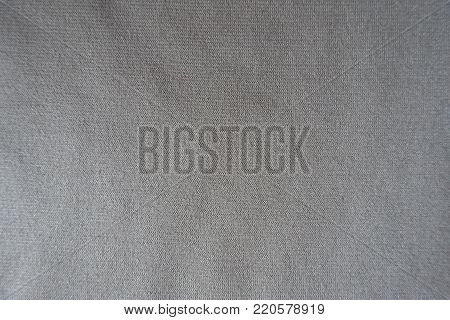 Surface of beige jersey fabric from above