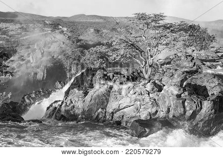 The top of the Ruacana waterfalls on the boder between Angola and Namibia. Monochrome
