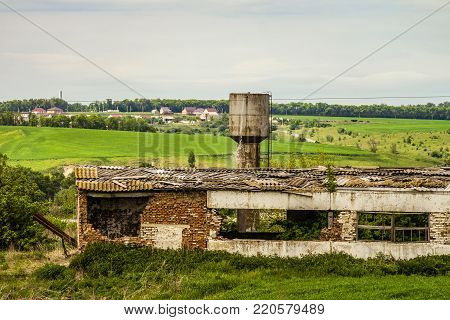 Old abandoned dilapidated agricultural building. Farm in decline. poster
