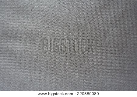 Unprinted simple  beige jersey fabric from above