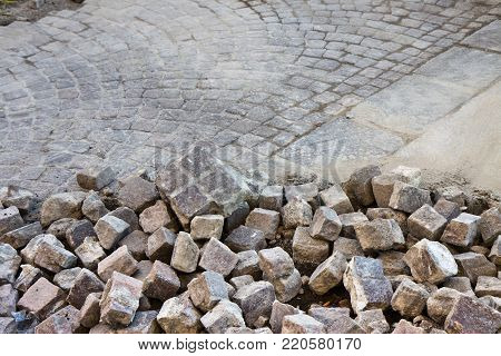 Road repairs in a porphyry road - image with copy space