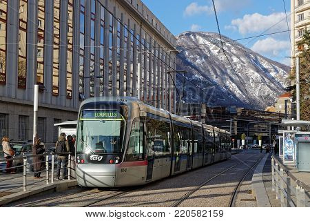 Grenoble, France, December 28, 2017 : Tramway And Mountains. Grenoble Prepares To Commemorate 50 Yea