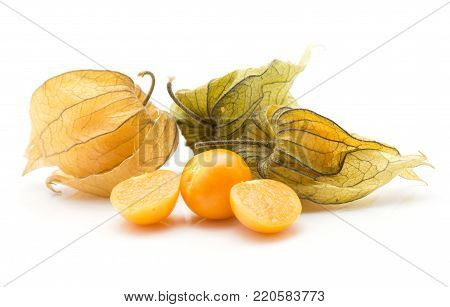 Physalis stack isolated on white background three in husk one orange berry cut in half and one whole