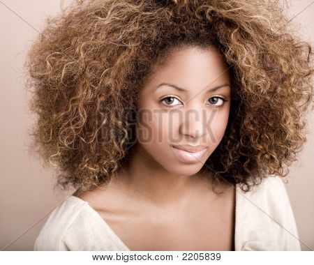 Portrait Of Multi-Ethnic Model With Big Hair