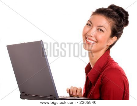 A Satisfied Asian Woman With Laptop