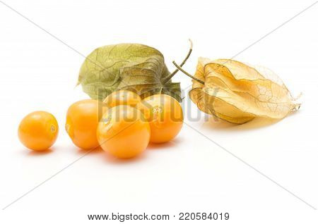 Physalis berries stack isolated on white background two in husk five orange