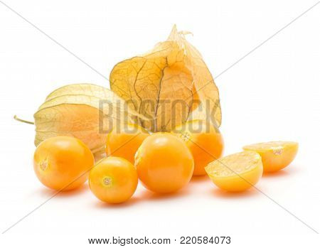 Physalis berries stack isolated on white background two in husk a lot of orange berries one sliced