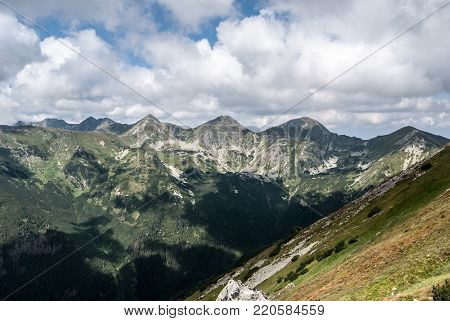 view to Rohace mountain group with Volovec, Ostry Rohac, Placlive, Tri kopy, Hruba kopa and Banikov peaks from Otrhance mountain ridge in Western Tatras mountains in Slovakia