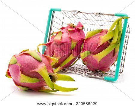 Dragon fruit (Pitaya, Pitahaya) fell out a shopping basket isolated on white background