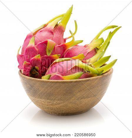 Dragon fruit (Pitaya, Pitahaya) in wooden bowl isolated on white background