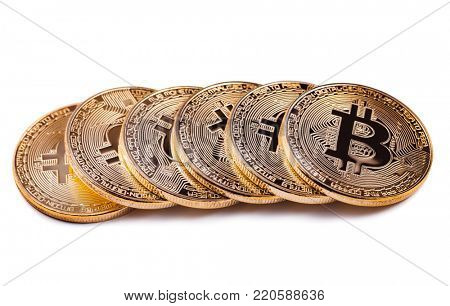 Macro view of shiny Bitcoin souvenire coins row, isolated on white