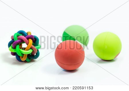 Pet supplies about ball toys for pet isolated on white.