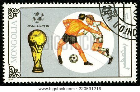 Ukraine - circa 2018: A postage stamp printed in Mongolia shows drawing Football duel. Trophy and soccer play. Italia 90. Series: World Cup Football. Circa 1990.