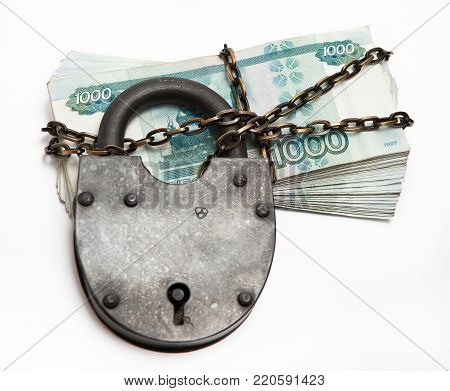 Russian banknotes in a circuit under a large iron lock