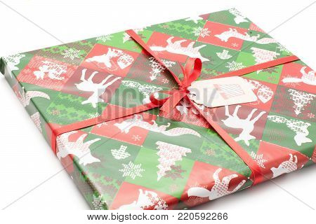 Present box tied by red bow and decorated by Christmas illustration (tree, animals, snowflake) isolated on white background