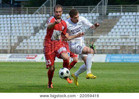KAPOSVAR, HUNGARY - MAY 14: Bojan Pavlovic (in white) in action at a Hungarian National Championship soccer game - Kaposvar vs Szolnok on May 14, 2011 in Kaposvar, Hungary.