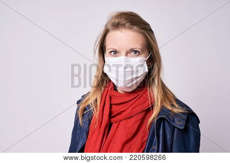 Protection from disease. Young girl. Epidemic. Gray background