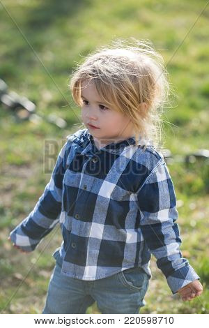 Baby Boy With Blond Hair In Plaid Blue Shirt, Jeans