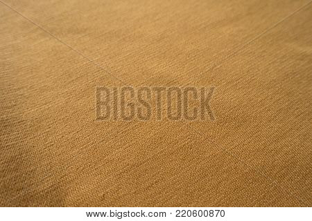 Closeup of simple amber yellow jersey fabric