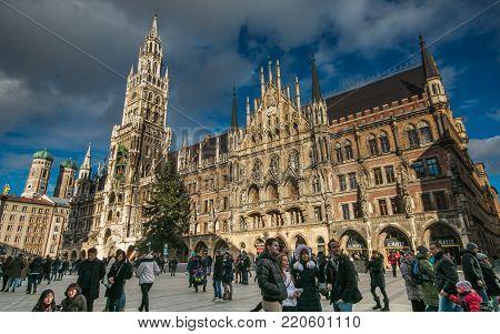MUNICH, GERMANY - JANUARY 1, 2018: Tourists in the beautiful Marienplatz of Munich at Christmas time