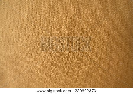 Top view of golden yellow jersey fabric