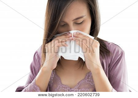 Asian Women In Satin Nightwear Feeling Unwell And Sneeze Against White Background, Dust Allergies, People Caught Cold And Allergy
