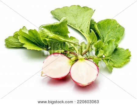 Sliced red radish, two halves, fresh green leaves, isolated on white background