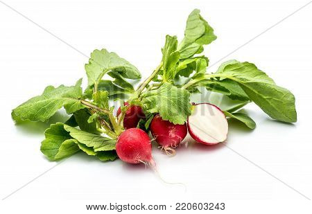 Group of whole and sliced red radish, one half, fresh green leaves, isolated on white background