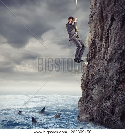 Businessman is likely to fall into the deep sea with sharks. concept of problems and difficulty in business