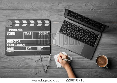 Female scriptwriter working at table, top view