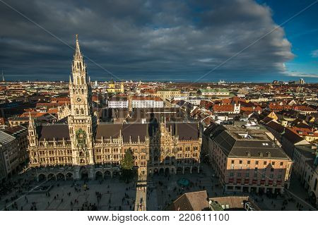 MUNICH, GERMANY - JANUARY 1, 2018: Aerial view of Munich city under dark clouds during winter day