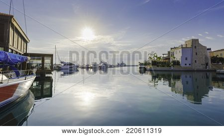 Beautiful Marina in Limassol city Cyprus. A modern, high end life and newly developed port with docked yachts, restaurants, shops, a landmark for waterfront promenade. View of the residential area at sunrise.