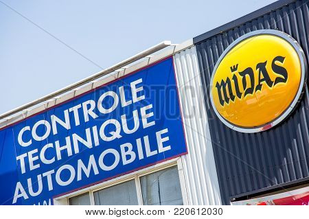 Argenteuil, France - April 23 2015: Facade With Midas Logo And Words Automotive Technical Control (