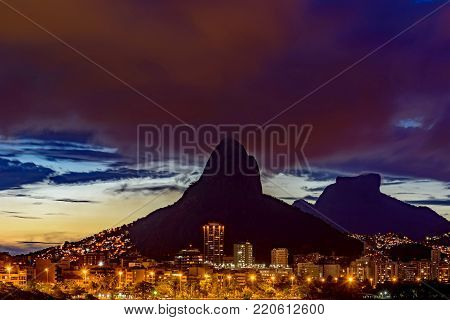 HDR image of the first nightfall of 2018 in the city of Rio de Janeiro seen from Rodrigo de Freitas lagoon with its lights, buildings and topography characteristic.