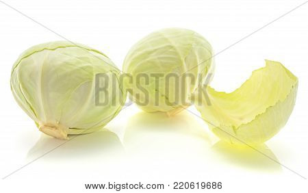 Two white cabbages with separated leaf isolated on white background