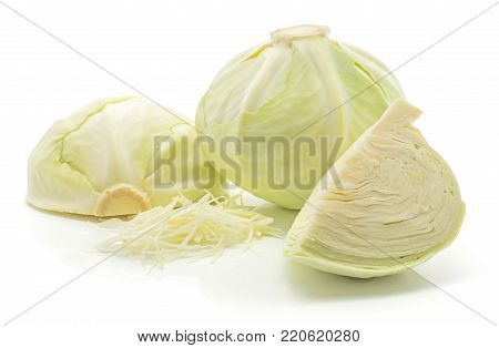 Chopped white cabbage, one whole head, one half and one quarter isolated on white background