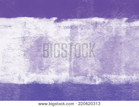 Violet rolled paint on a wall background