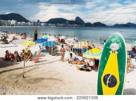 Rio de Janeiro, Brazil - January 3rd, 2018:  Long board with a Brazilian flag on Copacabana Beach, Rio de Janeiro, Brazil