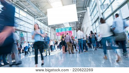 crowd of business people rushing in trade show hall, including copy space banner. ideal for websites and magazines layouts