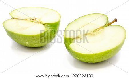 Sliced apple Granny Smith, two halves, isolated on white background poster