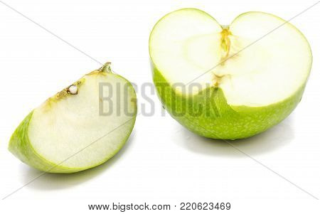 Granny Smith sliced apple, one half and slice, isolated on white background