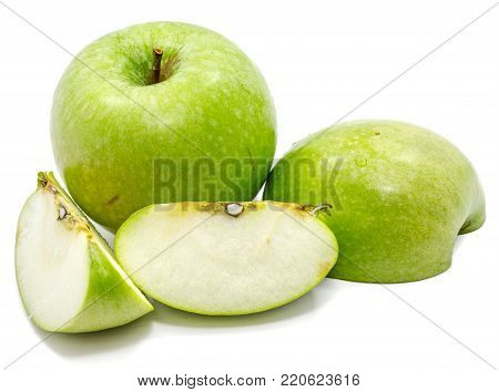 One whole apple Granny Smith, two slices and one half, isolated on white background