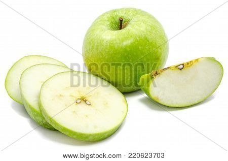 Group of sliced Granny Smith, one whole apple, circles and slices, isolated on white background